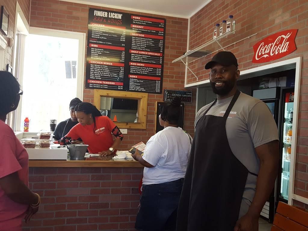 Finger Lickin BBQ & Wings   restaurant   218 N Orange St, New Smyrna Beach, FL 32168, USA   3864103427 OR +1 386-410-3427