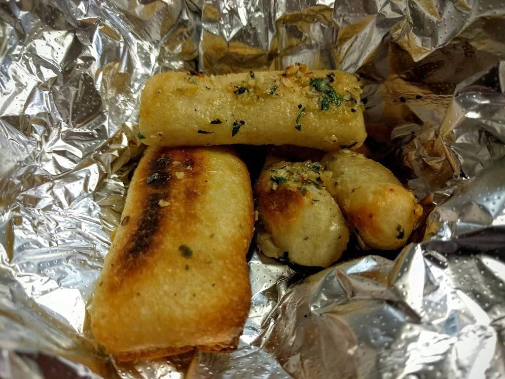 Mama Carmelas Pizza | restaurant | 49-14 30th Ave, Woodside, NY 11377, USA | 7187282026 OR +1 718-728-2026