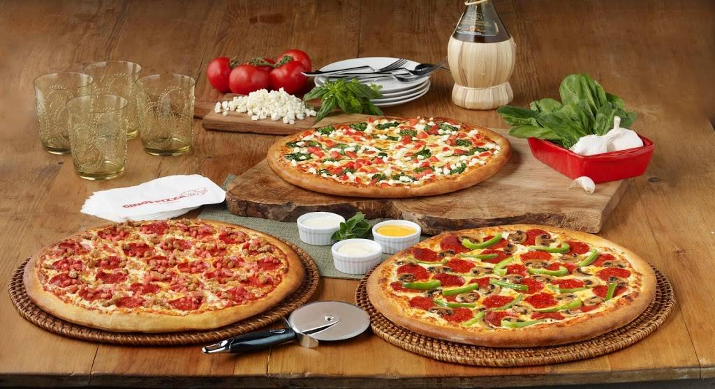 Ginos Pizza | restaurant | 180 Holiday Inn Dr, Cambridge, ON N3C 1Z4, Canada | 8663104466 OR +1 866-310-4466